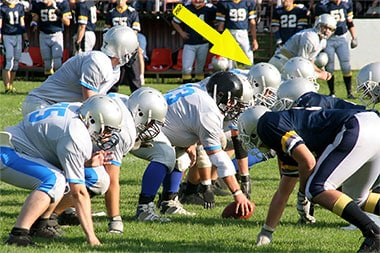 Do I Need to Make a Highlight Video article image of football team getting ready to hike the ball