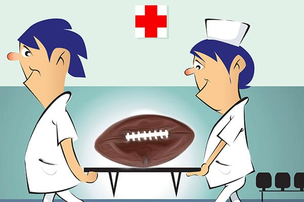 Football is dying cartoon picture of football being carried on a stretcher.